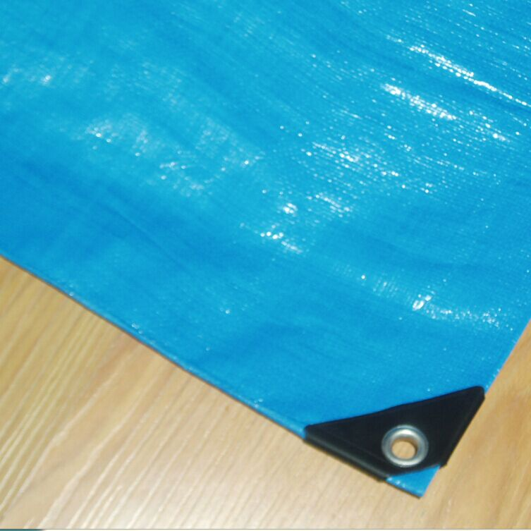 Blue tarp with reinforced corner