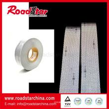 Coser solas garde cinta marino reflectante en chaqueta