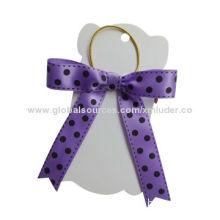 Dot printed purple ribbon bows with elastic loop
