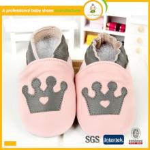 Zapatos de bebé de cuero verdaderos del cowskin genuino encantador de la venta caliente