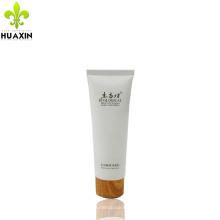 Envasado de tubo de crema facial de 120 ml con tapa de madera