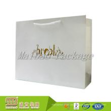 Bolso de empaquetado de papel de lujo del regalo de las compras de la cartulina reutilizable del color de las ventas al por mayor con el logotipo impreso