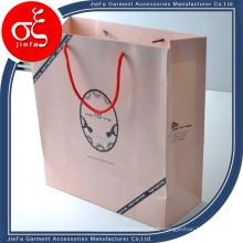 Le meilleur sac adapté aux besoins du client de papier d'emballage de vêtement d'habillement de prix