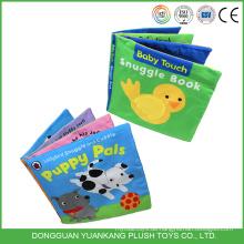 Pädagogisches Stoffbuch des weichen Spielzeugbabys