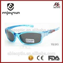 Óculos de sol de esportes transparentes para crianças de alta qualidade atacadistas