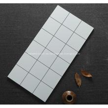Azulejo de mosaico cuadrado blanco y negro