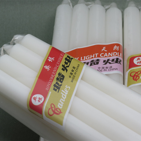 white candle with shrink paper