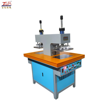Clothing label making machine with double oil pump