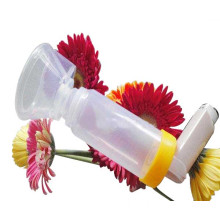 Valved holding chamber for asthma treatment