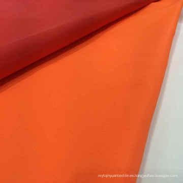Venta al por mayor 100% tejido de nylon de color sólido Tejido de recubrimiento de prendas de vestir