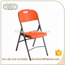 Wholesale cheap commerical furniture orange HDPE folding chair with iron legs for wedding