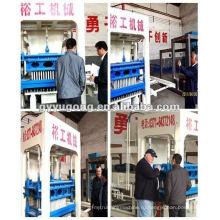 Yugong бетонный блок машина QT10-15 хорошо продается во всем мире