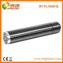 Venta al por mayor de la fábrica Material de aluminio Bolso ligero de la luz blanca 5 llevó la mini linterna con 1 * AA Battery