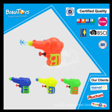 Kid playing water toy plastic imitation toy gun