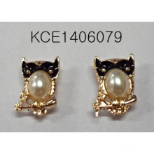 Owl Metal Earrings with a Large Pearl