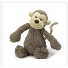 Juguetes de peluche mono encantador