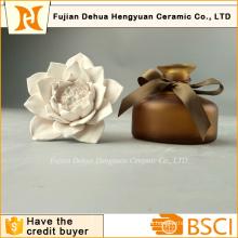 Botella de perfume de alta calidad con tapa de flores de cerámica