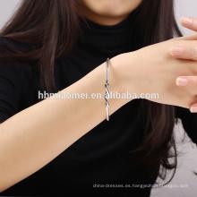 OEM venta al por mayor de Europa y los EE. UU. Vendiendo pulsera cruzada de oro rosa