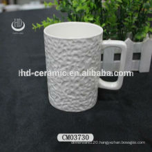 9oz ceramic coffee mug with square handle,embossed ceramic mug