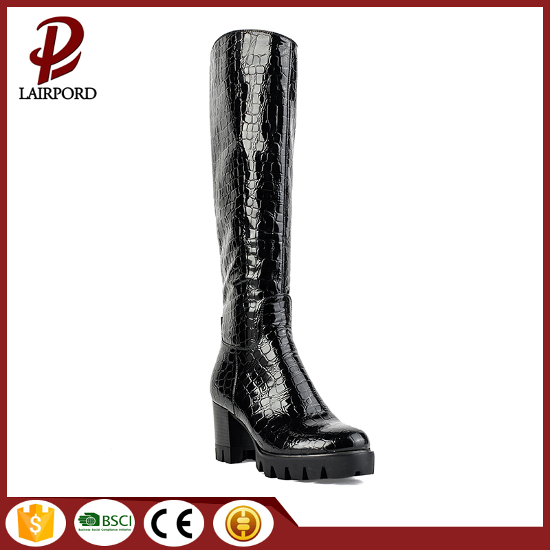 good quality black snakeskin mid-heel calf boots