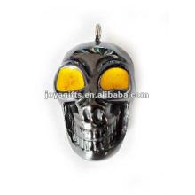 Petits pendentifs squelettes humain à l'hématite avec oeil jaune