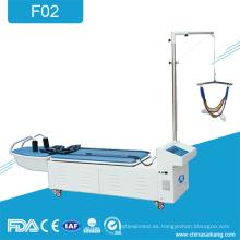 F02 Terapia física cama de tracción cervical y lumbar