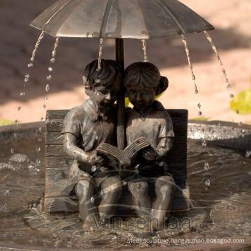 Children shaped sculptures Bronze Boy and Girl Umbrella Fountain