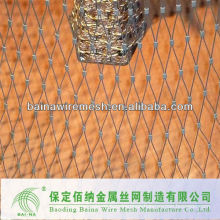 grassland fence or animal enclosure or knotted mesh