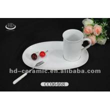 Taza de café de cerámica con la placa