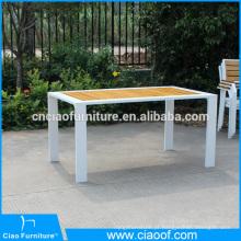 Mesa de jantar retangular de madeira teca ao ar livre