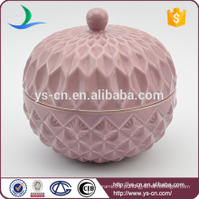 Recipiente de cerâmica em relevo rosa com tampa para casa