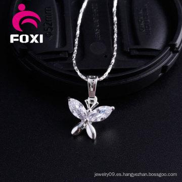 Encantador diseño colgante de mariposa de oro