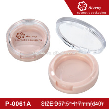 Caja redonda de polvo rosa compacta con espejo