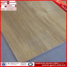 el proveedor de China el azulejo de piso de madera diseña la baldosa rústica con precio barato de las baldosas
