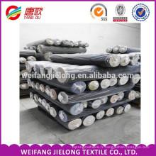 Un fil de coton de denim de tissu de denim de haute qualité de catégorie a teint le tissu de denim d'indigo pour la robe et la chemise de jeans