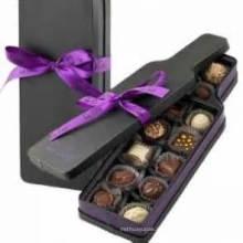 Boîte à chocolats créative avec plateau et ruban