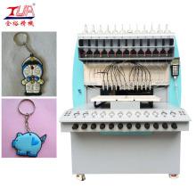 Machine à déposer les porte-clés en plastique souple