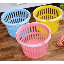Colorido portátil pequeña cesta redonda de plástico de almacenamiento con mango