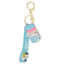 Porte-clés d'huile de chat de bouteille de lait acrylique