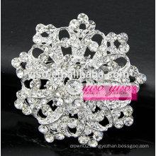 starburst crystal flower spiral brooch