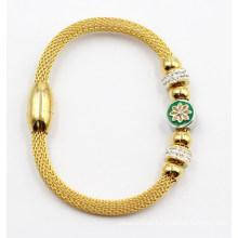 Gold überzogenes Edelstahl-Armband mit Charme