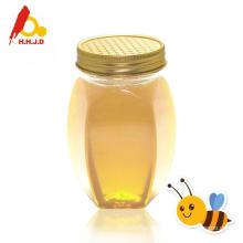 Flüssiger Akazienbienenhonig und -milch