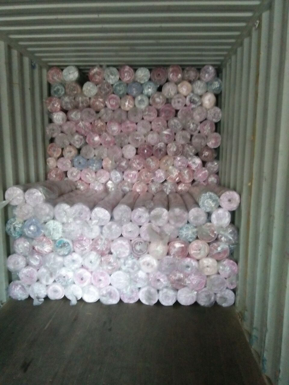 rolls fabric in loading