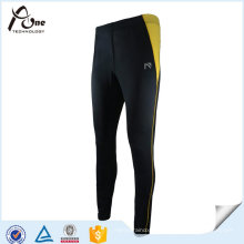 Calças justas de nylon da aptidão das mulheres do desgaste dos esportes da tela do Spandex