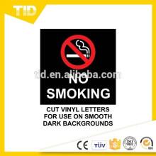 No fumar en el vehículo, etiqueta reflectante, tierra negra