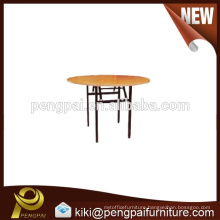 Round dinner table with metal leg