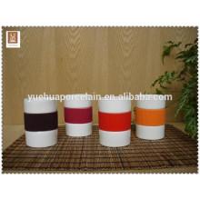 Alta calidad FDA y SGS taza de porcelana con mango de silicona