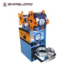 Machine de cachetage de tasse en plastique manuelle de tasse de jus d'acier inoxydable