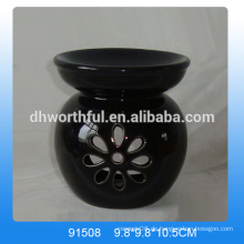 Handgefertigte schwarze Keramik-Aroma-Brenner mit blumenförmigem Aushöhl-Design
