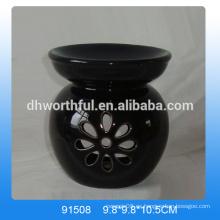 Quemador de aroma de cerámica negra hecha a mano con diseño hueco en forma de flor